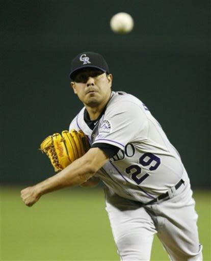 Colorado Rockies pitcher Jorge De La Rosa throws in the first inning during a baseball game against the Arizona Diamondbacks on Friday, July 5, 2013, in Phoenix. (AP Photo/Rick Scuteri)