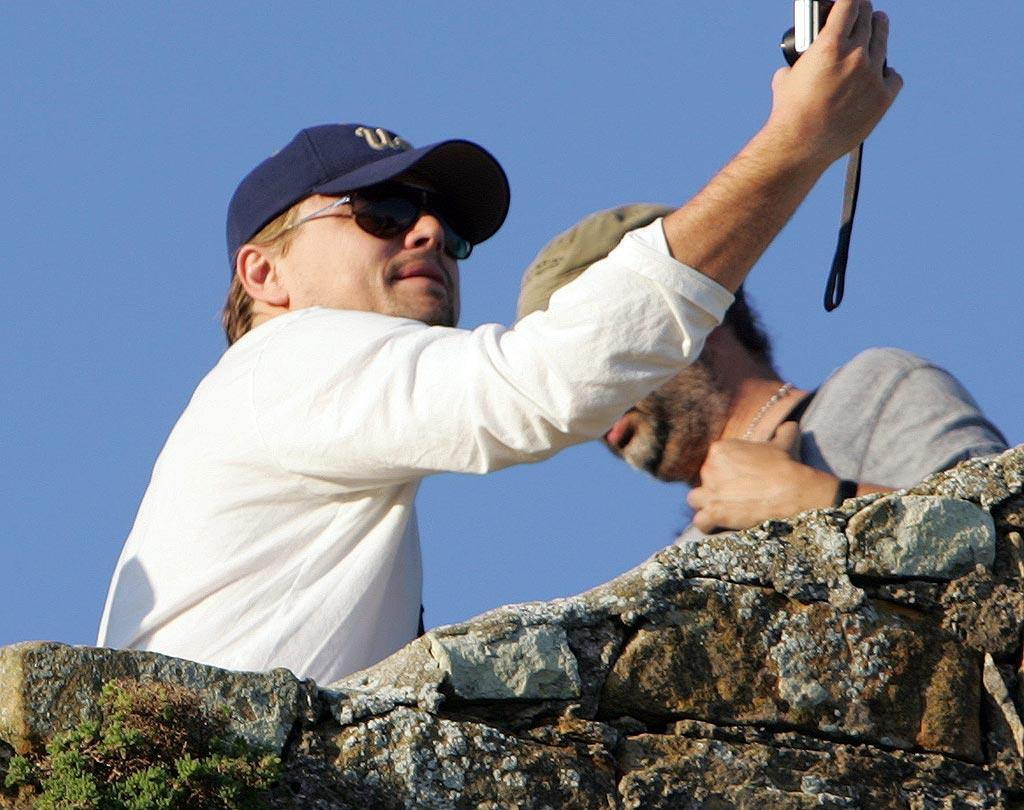 "Later, the 35-year-old actor took some time to go sightseeing at the Cape Point Nature Reserve. Leo even took a self portrait! <a href=""http://www.infdaily.com"" target=""new"">INFDaily.com</a> - July 3, 2010"