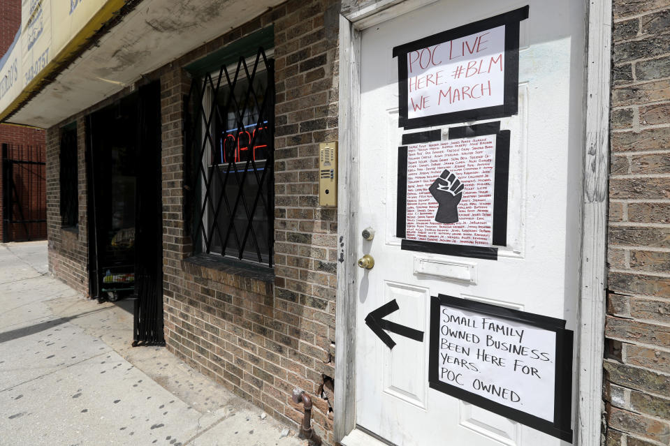 FILE - In this June 5, 2020, file photo, signs supporting Black Lives Matter are displayed at the front door of a residence in Wicker Park in Chicago. The Black Lives Matter Global Network Foundation, which grew out of the creation of the Black Lives Matter movement, is formally expanding a $3 million financial relief fund that it quietly launched in February 2021, to help people struggling to make ends meet during the ongoing coronavirus pandemic. (AP Photo/Nam Y. Huh, File)