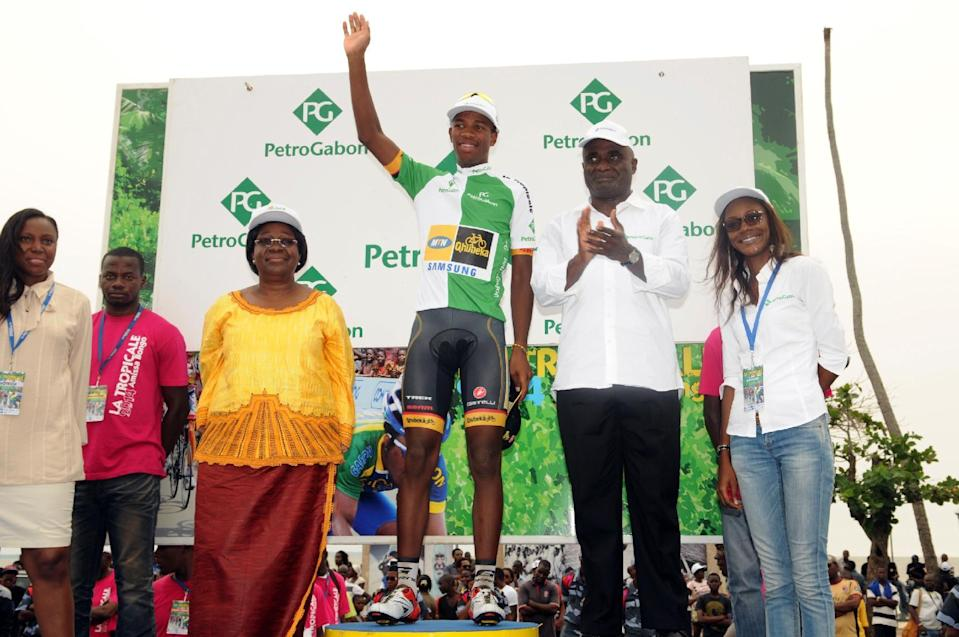 Team MTN Qhubeka cyclist Jim Songezo (centre) celebrates on the podium in Libreville on January 19, 2014 after he was elected best combative rider of the 9th Tropicale Amissa Bongo 2014 (Tour du Gabon) (AFP Photo/Serge Rogers)