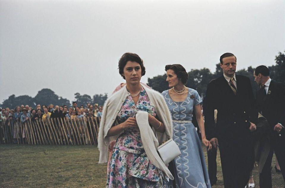 <p>A young Princess Margaret opted to wear a fuzzy cream cardigan over her shoulders for a 1955 polo tournament at Great Windsor Park. </p>