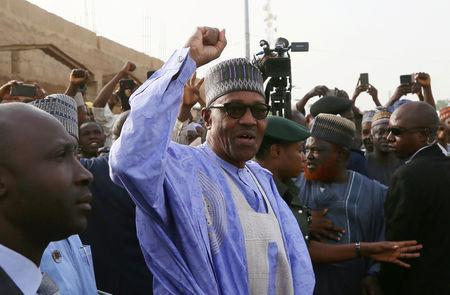 FILE PHOTO: Nigerian President Muhammadu Buhari gestures as he arrives to cast a vote in Nigeria's presidential election at a polling station in Daura, Katsina State, Nigeria, February 23, 2019. REUTERS/Afolabi Sotunde/File Photo