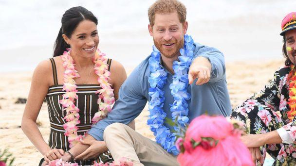 PHOTO: Meghan and Prince Harry talk to members of OneWave, an awareness group for mental health and well-being at South Bondi Beach, Oct. 19, 2018, in Sydney, Australia. (Paul Edwards/Getty Images)