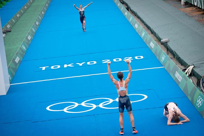 <p>Winner Bermuda's Flora Duffy (C), third-placed USA's Katie Zaferes (top L) and second-placed Britain's Georgia Taylor-Brown (R) react after completing the women's individual triathlon competition during the Tokyo 2020 Olympic Games at the Odaiba Marine Park in Tokyo on July 27, 2021. (Photo by Loic VENANCE / AFP)</p>