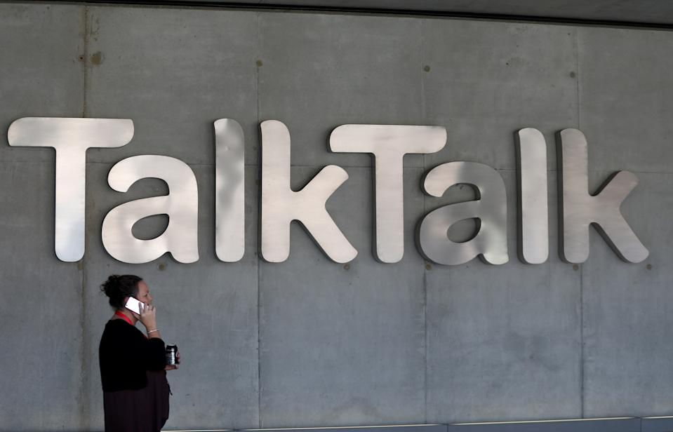 A woman speaks on her phone as she passes a branded logo outside the Talktalk headquarters in London, Britain May 10, 2017. REUTERS/Neil Hall