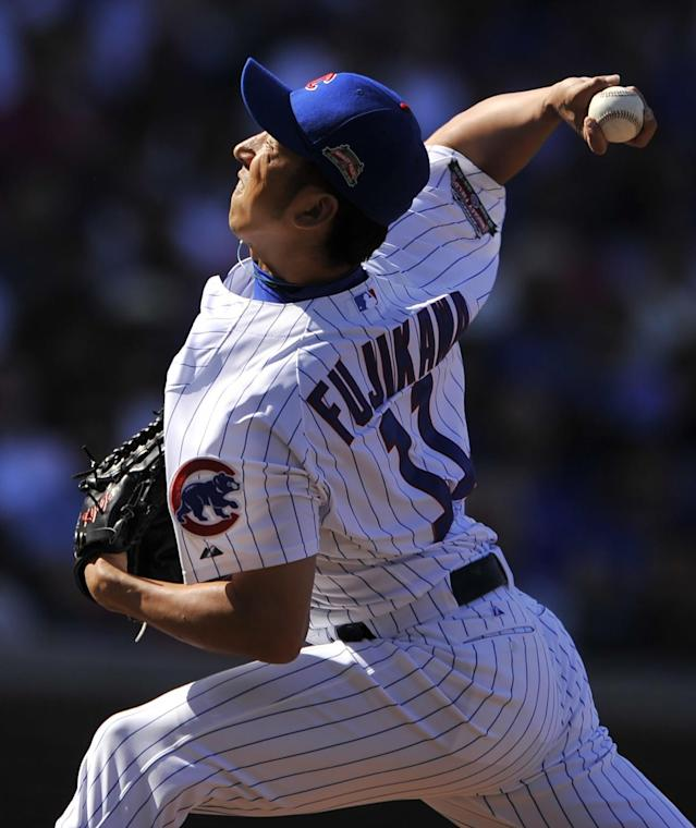 Chicago Cubs relief pitcher Kyuji Fujikawa of Japan, delivers a pitch during the eighth inning of a baseball game against the Milwaukee Brewers in Chicago, Thursday, Aug. 14, 2014. (AP Photo/Paul Beaty)