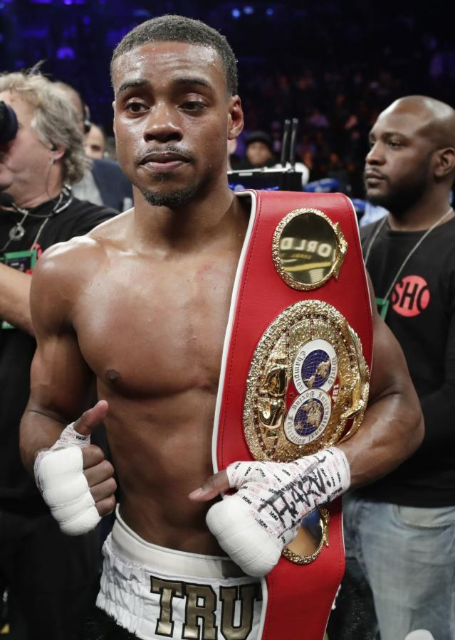 FILE - In this Jan. 20, 2018, file photo, Errol Spence Jr. poses for photographs after an IBF welterweight championship boxing match against Lamont Peterson, in New York. The 2012 U.S. Olympian will defend his IBF crown back home in Texas on Saturday night, June 16, against Mexicos Carlos Ocampo in a mandatory defense between undefeated fighters. (AP Photo/Frank Franklin II, File)