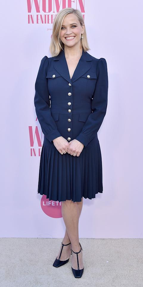 """<p>Reese Witherspoon wore a pleated blazer dress by <a href=""""https://click.linksynergy.com/deeplink?id=93xLBvPhAeE&mid=1237&murl=https%3A%2F%2Fshop.nordstrom.com%2Fbrands%2Fmichael-kors-collection--14702&u1=IS%2CReeseWitherspoon%2Canesta%2C%2CIMA%2C3506459%2C201912%2CI"""" target=""""_blank"""">Michael Kors</a> with <a href=""""https://click.linksynergy.com/deeplink?id=93xLBvPhAeE&mid=37499&murl=https%3A%2F%2Fus.jimmychoo.com%2Fen%2Fsale%2Fwomen-sale%2Fshoes%2Flexica-100%2Fdark-green-croc-embossed-leather-t-bar-pumps-LEXICA100CCL031838.html&u1=IS%2CReeseWitherspoon%2Canesta%2C%2CIMA%2C3506459%2C201912%2CI"""" target=""""_blank"""">Jimmy Choo T-strap heels</a> and Tiffany & Co. jewelry to <em>The Hollywood Reporte</em>r's 100 Women in Entertainment event.</p>"""