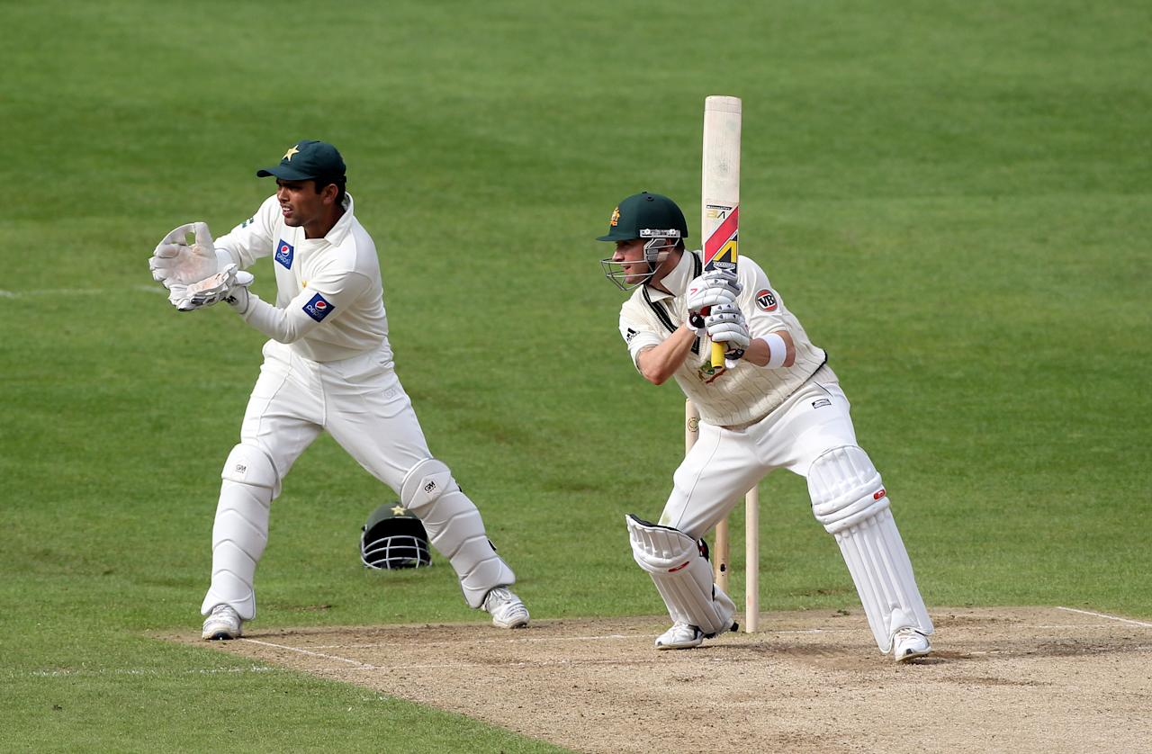 LEEDS, ENGLAND - JULY 22: Kamran Akmal looks on as Michael Clarke of Australia hits out during day two of the 2nd Test between Pakistan and Australia at Headingley Carnegie Stadium on July 22, 2010 in Leeds, England.  (Photo by Julian Herbert/Getty Images)