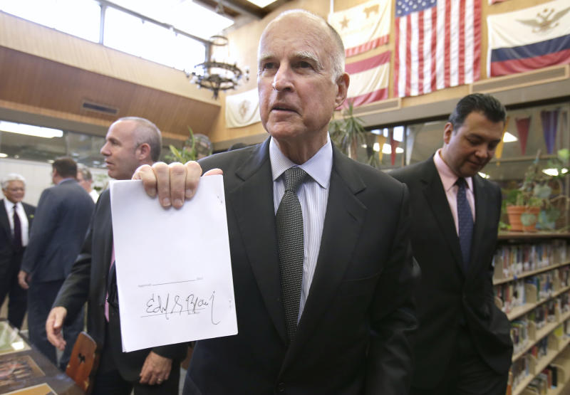 Brown signs school-funding changes into law