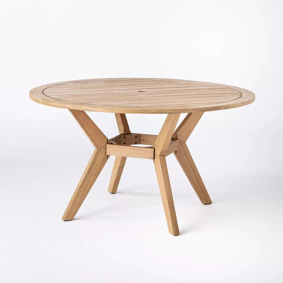 <p>Give your backyard a cottage feel with the <span>Bluffdale Wood Round Patio Dining Table</span> ($450).</p>
