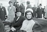 <p>The President and First Lady leave the Capitol following his swearing-in ceremony to become the 35th President of the United States. Jackie wears a coat with mod oversize buttons, and the cloth pillbox hat (designed by Halston) set a new tone for the young couple of the White House.<br></p>