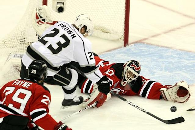 NEWARK, NJ - JUNE 09: Martin Brodeur #30 of the New Jersey Devils tries to make a save against Dustin Brown #23 of the Los Angeles Kings during Game Five of the 2012 NHL Stanley Cup Final at the Prudential Center on June 9, 2012 in Newark, New Jersey. (Photo by Jim McIsaac/Getty Images)