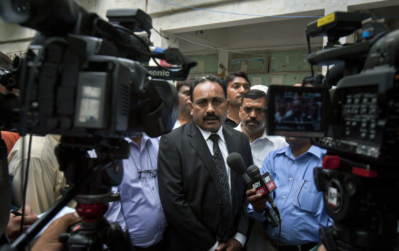 Tahir Naveed Chaudhry, the lawyer of a Christian girl accused of blasphemy, talks to media after a court hearing in Islamabad, Pakistan on Tuesday, Aug. 28, 2012. Chaudhry said a report by a medical board investigating the age and mental state of the girl determined she was between 13 and 14. The girl was accused by a neighbor of burning pages from the Quran. (AP Photo/Anjum Naveed)
