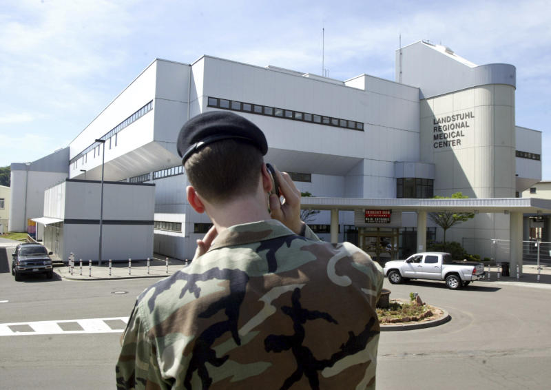FILE - In this May 26, 2005 file photo a soldier stands in front of the Landstuhl Regional Medical Center in Landstuhl, Germany. An American and an Australian who were freed by the Taliban earlier this week after three years in captivity are now in Germany receiving treatment at a U.S. military hospital.American Kevin King and Australian Timothy Weeks were met at the U.S. Air Force's Ramstein base in southern Germany by U.S. Ambassador Richard Grenell and Australian Ambassador Lynette Wood when they arrived late Wednesday night, an American official said. (AP Photos/Michael Probst,file)