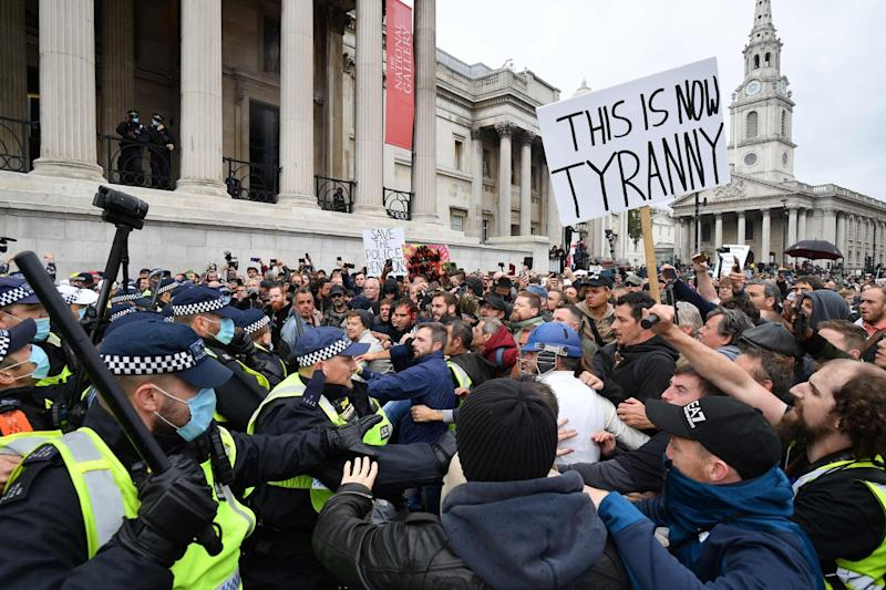 Police clash with protesters (AFP via Getty Images)