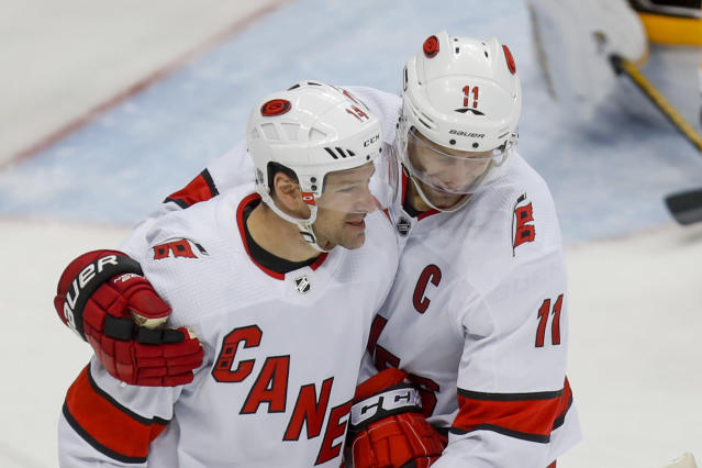 Carolina Hurricanes' Justin Williams (14) celebrates with Jordan Staal after scoring against the Pittsburgh Penguins during the third period of an NHL hockey game, Sunday, March 8, 2020, in Pittsburgh. The Hurricanes won 6-2. (AP Photo/Keith Srakocic)