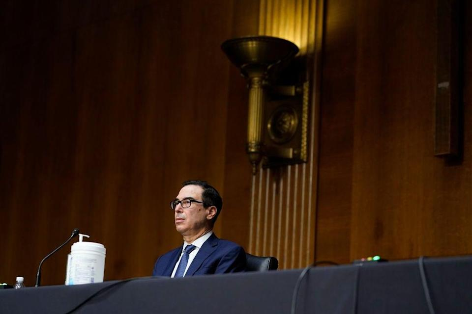 Trump Treasury Secretary Steven Mnuchin faced a grilling from Democratic lawmakers about his decision to pull funding for key Federal Reserve lending programmes for municipal funds, medium-sized businesses, and others. (Getty Images)