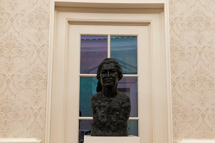 The Oval Office of the White House is newly redecorated for the first day of President Joe Biden's administration, Wednesday, Jan. 20, 2021, in Washington, including a bust of civil rights leader Rosa Parks. (AP Photo/Alex Brandon) ORG XMIT: DCAB123