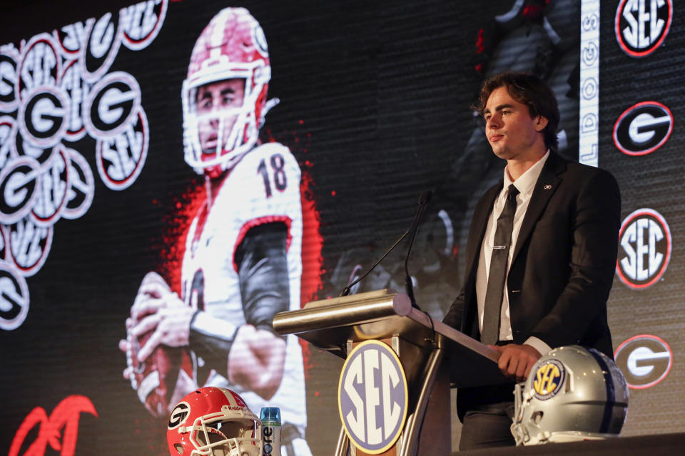 Georgia's JT Daniels speaks to reporters during the NCAA college football Southeastern Conference Media Days Tuesday, July 20, 2021, in Hoover, Ala. (AP Photo/Butch Dill)