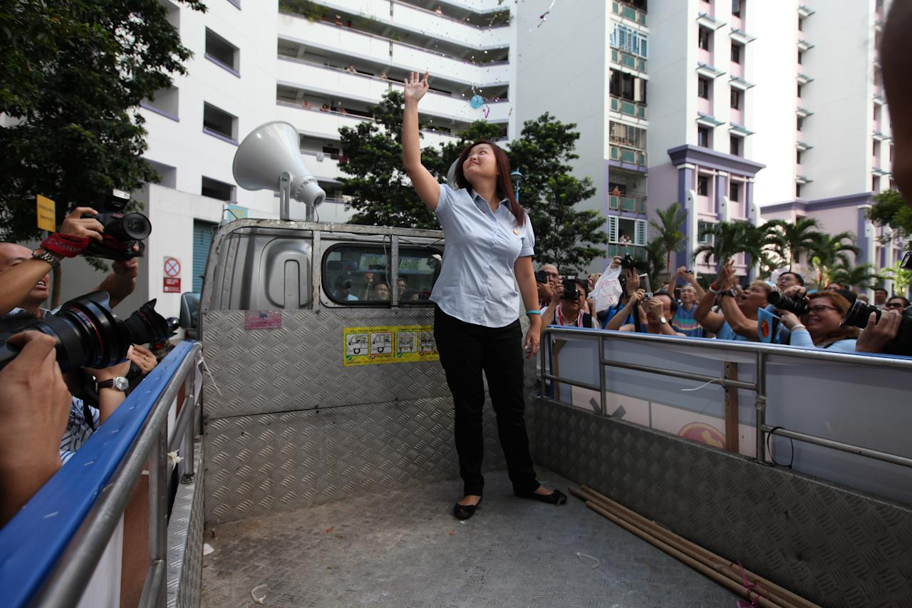 WP's Lee Li Lian showing her appreciation to Punggol East residence at the thank you parade.