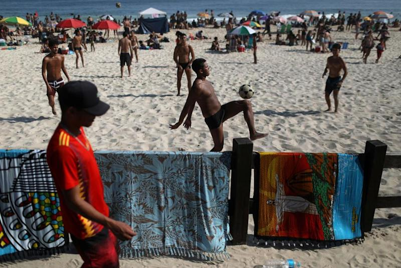 People play football at Ipanema beach in Rio last week.