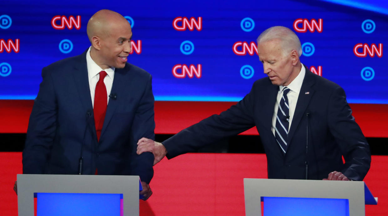'You're dipping into the Kool-Aid': Booker and Biden clash on criminal  justice