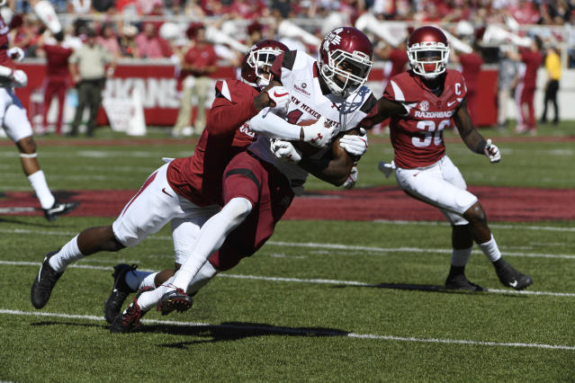 "Arkansas defender Kamren Curl tackles New Mexico State receiver <a class=""link rapid-noclick-resp"" href=""/ncaaf/players/264166/"" data-ylk=""slk:Jaleel Scott"">Jaleel Scott</a> in the first half of an NCAA college football game in Fayetteville, Ark., Saturday, Sept. 30, 2017. Arkansas won the game 42-24. (AP Photo/Michael Woods)"