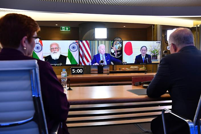 Australia's Prime Minister Scott Morrison, right, and Minister for Foreign Affairs Marise Payne, left, participate in the inaugural Quad leaders meeting with the President of the United States Joe Biden, the Prime Minister of Japan Yoshihide Suga and the Prime Minister of India Narendra Modi in a virtual meeting in Sydney, Saturday, March 13, 2021.