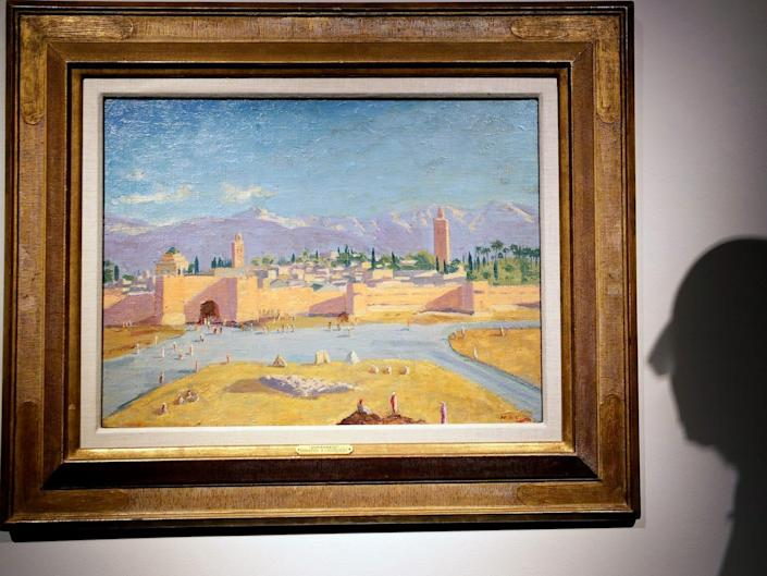 An oil on canvas painting by Sir Winston Churchill Painted in Jan. 1943 called 'Tower of the Koutoubia Mosque' is displayed at Christie's auction rooms in London, Friday, Jan. 29, 2021. The painting currently owned by Angelina Jolie, has an estimate of 1,500,000-2,500,000 UK pounds (2,056,489- 3,427,482 US Dollars) and will go up for sale in the Modern British Art Evening Sale at Christie's on March 1, 2021. (AP Photo/Kirsty Wigglesworth)