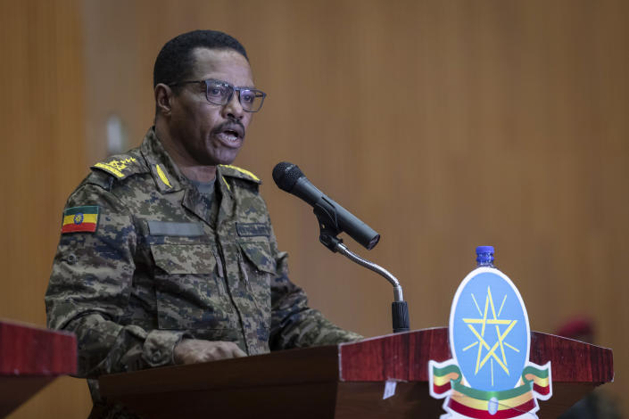 Lieutenant-General Bacha Debele of the Ethiopian National Defense Force gives a joint press conference with State Minister of Foreign Affairs and Spokesperson for the State of Emergency Taskforce Redwan Hussein about the current situation in the country's northern Tigray region, in the capital Addis Ababa, Ethiopia Wednesday, June 30, 2021. (AP Photo/Mulugeta Ayene)