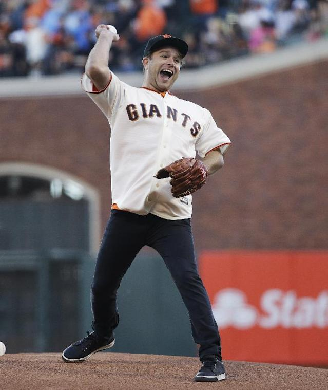 Robin Williams' son, Zak Williams throws out the ceremonial first pitch before Game 5 of baseball's World Series between the Kansas City Royals and the San Francisco Giants Sunday, Oct. 26, 2014, in San Francisco. (AP Photo/Matt Slocum)
