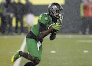 Oregon running back DeAnthony Thomas returns a punt on the first play during the first half of an NCAA college football game against California in Eugene, Ore., Saturday, Sept. 28, 2013. Thomas was injured on the play and had to be helped off the field.(AP Photo/Don Ryan)