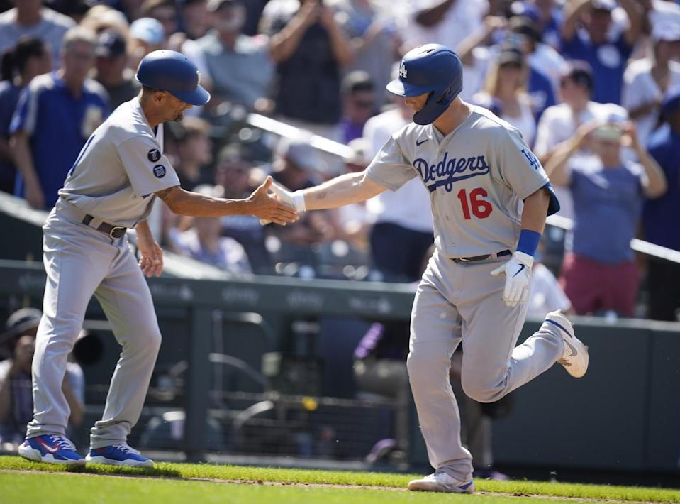 Dodgers third base coach Dino Ebel, left, congratulates Will Smith as he rounds the bases after hitting a two-run homer.