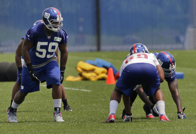 New York Giants linebacker Devon Kennard (59) listens for the snap count during NFL football minicamp, Tuesday, June 17, 2014, in East Rutherford, N.J. (AP Photo/Julie Jacobson)
