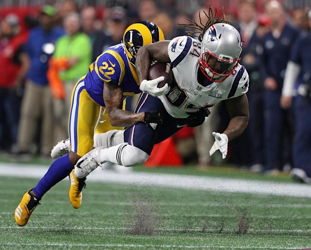 <p>Marcus Peters brings down the Patriots Cordarrelle Patterson after a second quarter gain. The New England Patriots met the Los Angeles Rams in Super Bowl LIII at Mercedes-Benz Stadium. (Jim Davis /Globe Staff) </p>
