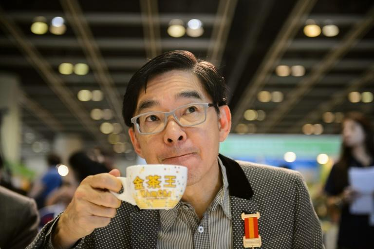 A competition judge samples some milk tea during judging in the Hong Kong Style Milk Tea international final held during the 2016 Hong Kong International Tea Fair on August 13, 2016