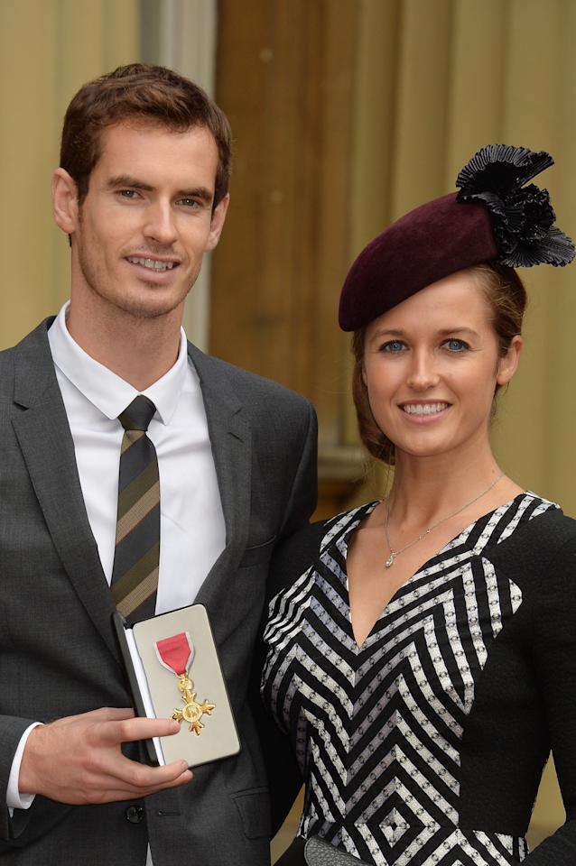 LONDON, ENGLAND - OCTOBER 17: Wimbledon champion Andy Murray and his long time girlfriend Kim Sears pose at Buckingham Palace on October 17, 2013 in London, England. Murray was awarded the Order of the British Empire (OBE) from Prince William, Duke of Cambridge. (Photo by John Stillwell - WPA Pool/Getty Images)