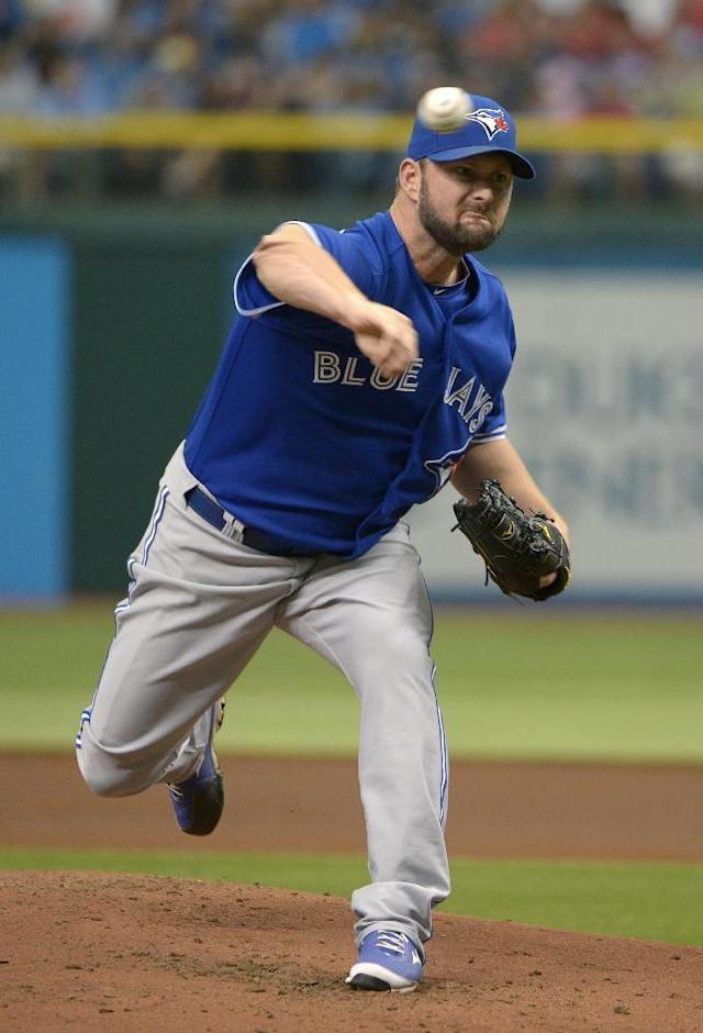Toronto Blue Jays starting pitcher Todd Redmond throws to home plate during the first inning of a baseball game against the Tampa Bay Rays in St. Petersburg, Fla., Sunday, Aug. 18, 2013. (AP Photo/Phelan M. Ebenhack)