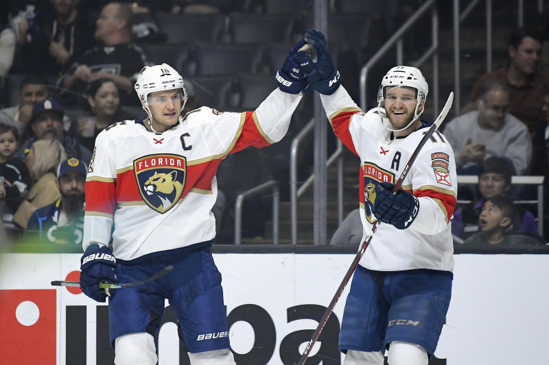 Florida Panthers center Aleksander Barkov, left, celebrates his goal with left wing Jonathan Huberdeau during the first period of an NHL hockey game against the Los Angeles Kings Thursday, Feb. 20, 2020, in Los Angeles. (AP Photo/Mark J. Terrill)