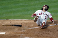 Los Angeles Angels' Anthony Rendon falls down after hitting a foul ball off his leg during the eighth inning of a baseball game against the Tampa Bay Rays Monday, May 3, 2021, in Anaheim, Calif. (AP Photo/Marcio Jose Sanchez)