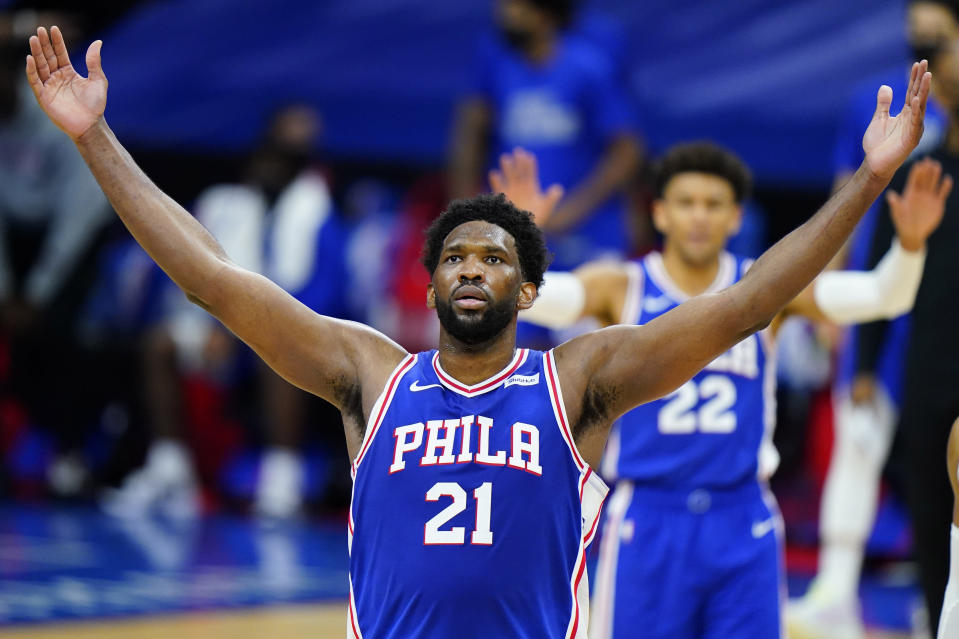 FILE - In this Feb. 19, 2021, file photo, Philadelphia 76ers' Joel Embiid reacts after making a basket during the second half of an NBA basketball game against the Chicago Bulls in Philadelphia. Embiid is having the best season for a 76ers' big man since Moses Malone and he has his team atop the Eastern Conference standings headed into the second half of the season. (AP Photo/Matt Slocum, File)