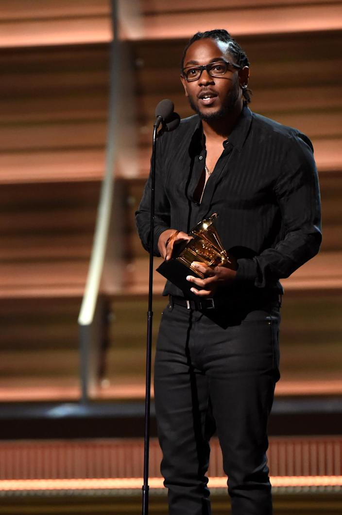"<p>Lamar accepts the Grammy for best rap album for ""To Pimp a Butterfly"" on Monday, February 15, 2016. Taylor Swift beat him out for best album. (Photo by Jeff Kravitz/FilmMagic)</p>"