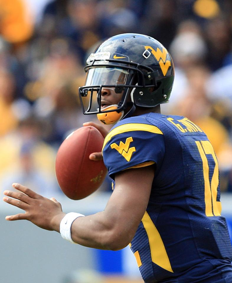 West Virginia quarterback Geno Smith (12) looks for a receiver during their NCAA college football game against Baylor in Morgantown, W.Va., Saturday, Sept. 29, 2012. (AP Photo/Christopher Jackson)