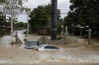 Submerged cars are pictured at an area affected by floods after the passage of Storm Eta, in El Progreso