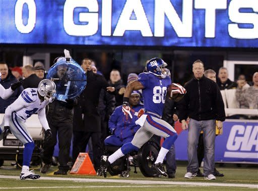 Dallas Cowboys cornerback Terence Newman (41) fails to catch New York Giants wide receiver Victor Cruz (80) as he runs down the sideline to score on a 74-yard touchdown pass during the first half of an NFL football game Sunday, Jan. 1, 2012, in East Rutherford, N.J. (AP Photo/Julio Cortez)
