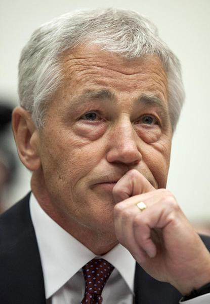 Defense Secretary Chuck Hagel pauses while testifying on Capitol Hill in Washington, Thursday, April 11, 2013, before the House Armed Services Committee hearing on the Defense Department's fiscal 2014 National Defense Authorization Budget Request. (AP Photo/Carolyn Kaster)