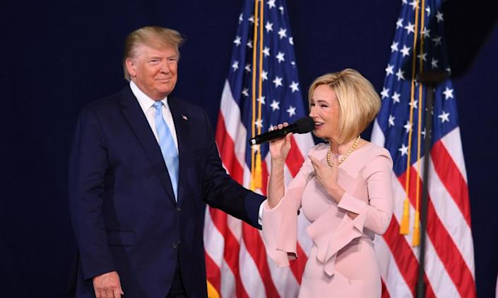 Trump with and Paula White in Miami this month.