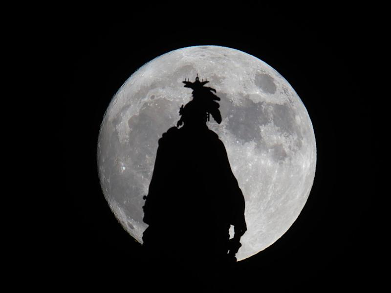 A super moon rises over the Statue of Freedom on the Capitol dome in Washington, DC November 13, 2016: AFP