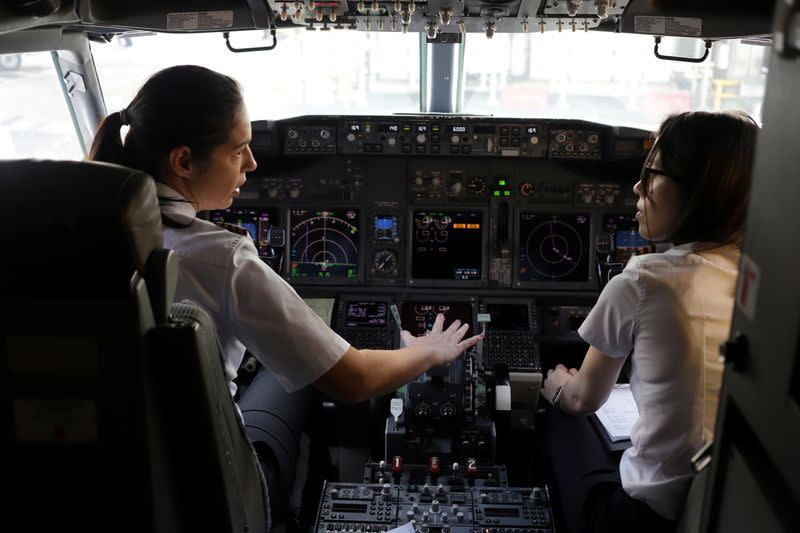 FILE PHOTO: Captain Natalia Weiss and co-pilot Thays Goncalves of Brazilian Airline GOL prepare before taking off with a full female crew in the mark of International Women's Day, in Sao Paulo